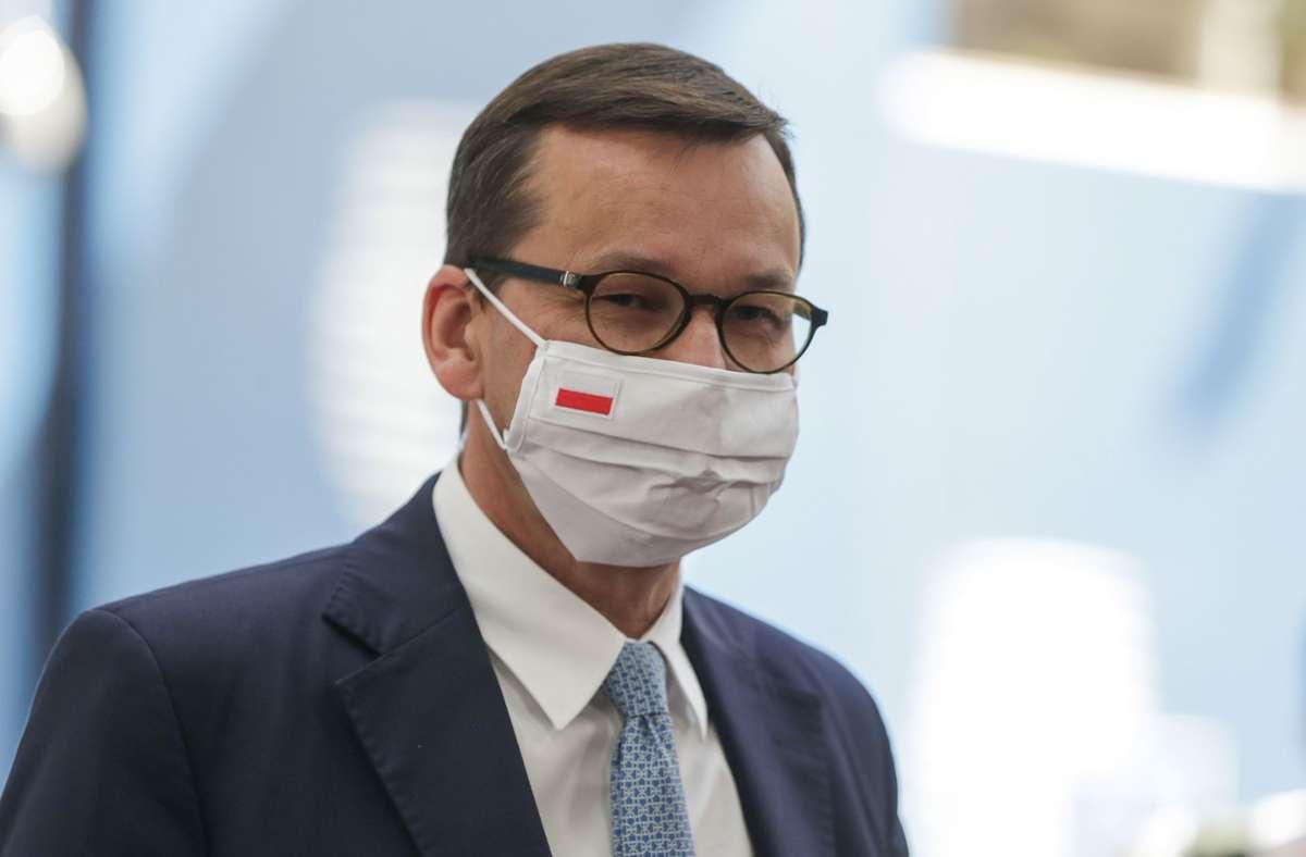 Ministerpräsident Mateusz Morawiecki von Polen hat drastische Maßnahmen gegen die Verbreitung des Coronavirus in seinem Land verkündet. (Archivbild) Foto: AFP/STEPHANIE LECOCQ