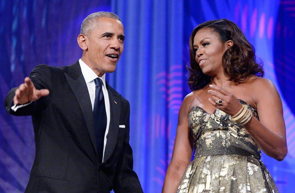 Michelle und Barack Obama haben gute Laune – sie wollen für Netflix neue Programme entwickeln. Foto: dpa