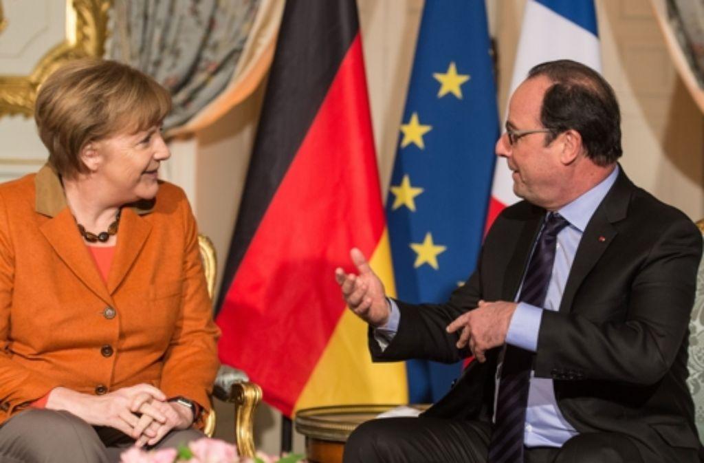 Angela Merkel braucht für ihre Flüchtlingspolitik Frankreichs Präsident Hollande, Doch Ministerpräsident Valls hat nun angekündigt, Frankreich werde keine Flüchtlinge mehr aufnehmen. Foto: POOL