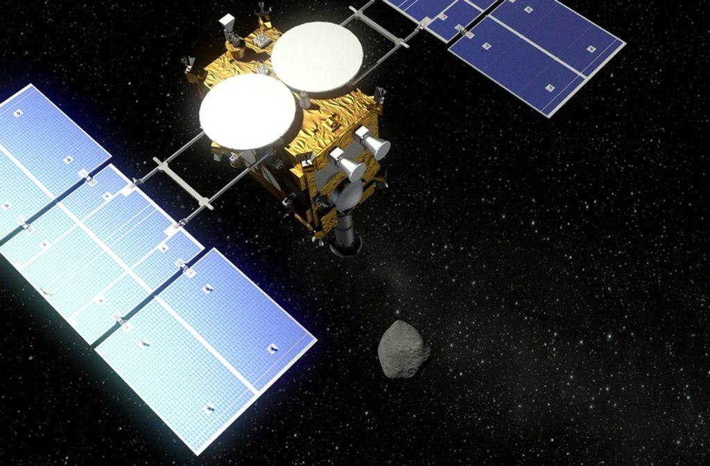 Der Asteroidenlander Mascot fliegt mit der japanischen Raumsonde Hayabusa2 (undatierte Visualisierung) zum Asteroiden 1999 JU 3. Foto: DLR/dpa