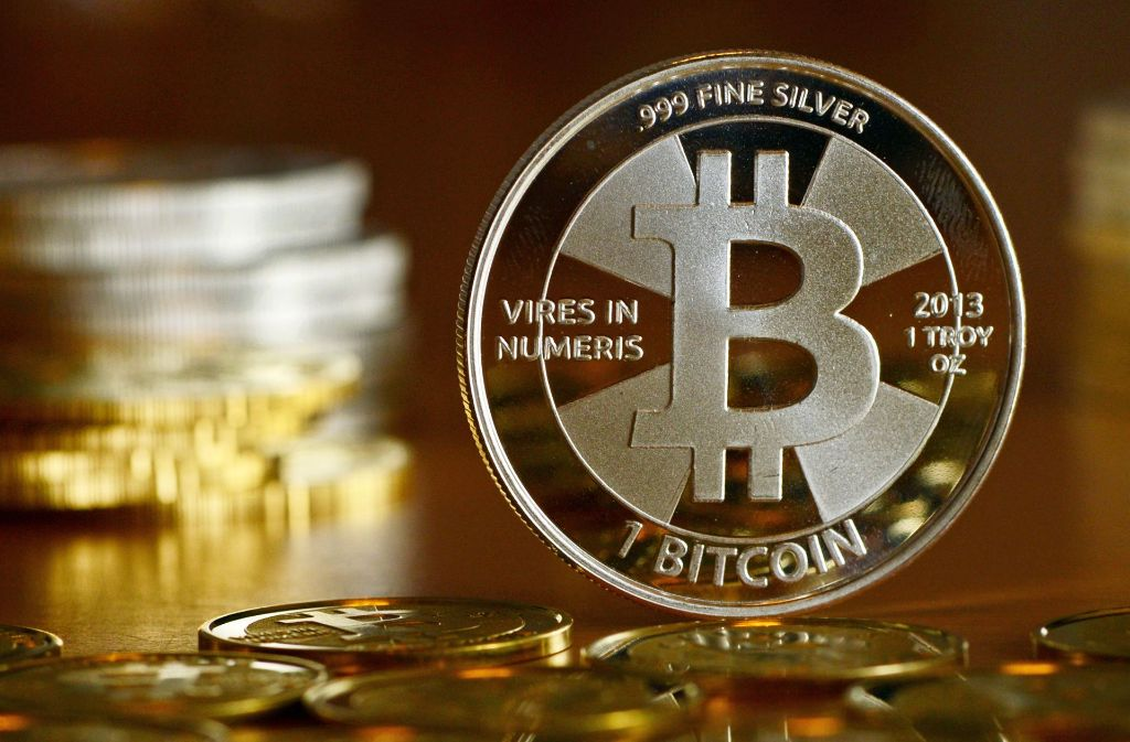 Bitcoins sind eigentlich virtuelle Münzen, dies ist praktisch ein Gutschein. Foto: dpa