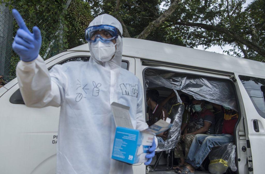 Die Infektionsrate scheint in Teilen der Entwicklungsländer mit einem schlechten oder inexistenten Gesundheitssystem relativ niedrig zu liegen. Foto: dpa/Mustaqim Khairuddin