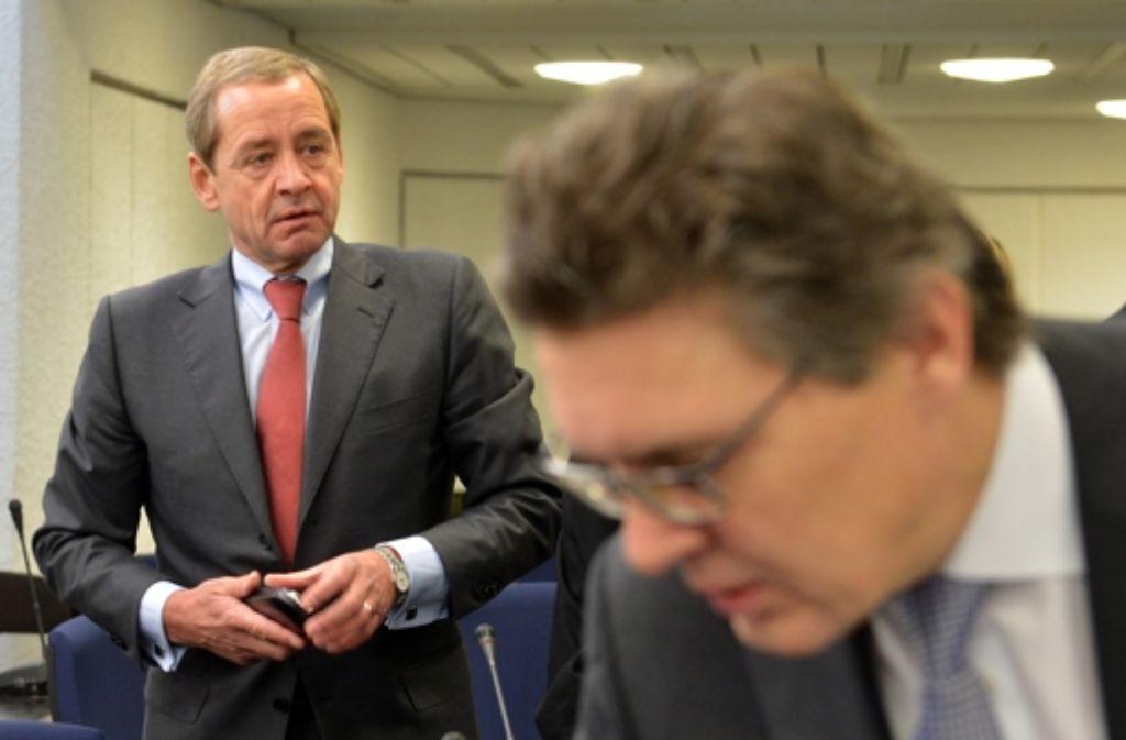 Exchef Jaschinski (vorn) und der freigestellte Banker Horn beteuern ihre Unschuld. Foto: dpa