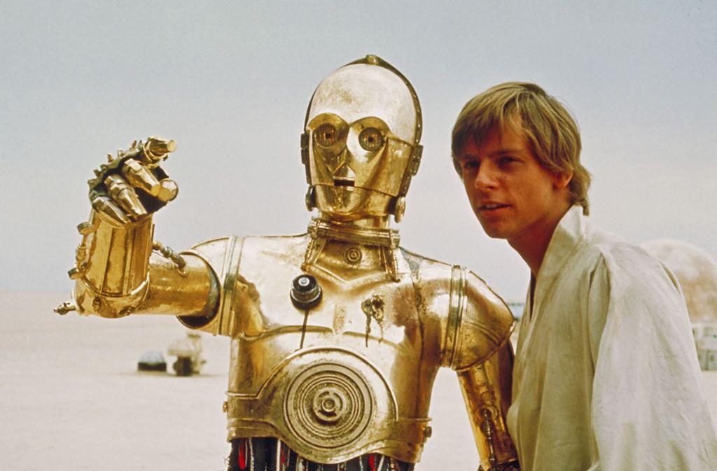 C3PO und Luke Skywalker (rechts) sind unter den bekanntesten Gesichtern des Star-Wars-Universums. Foto: AP