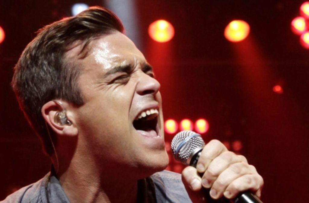 Der Entertainer Robbie Williams hat eine bewegtes Leben. In der Fotostrecke zeigen wir einige Stationen seiner Karriere. Foto: PA