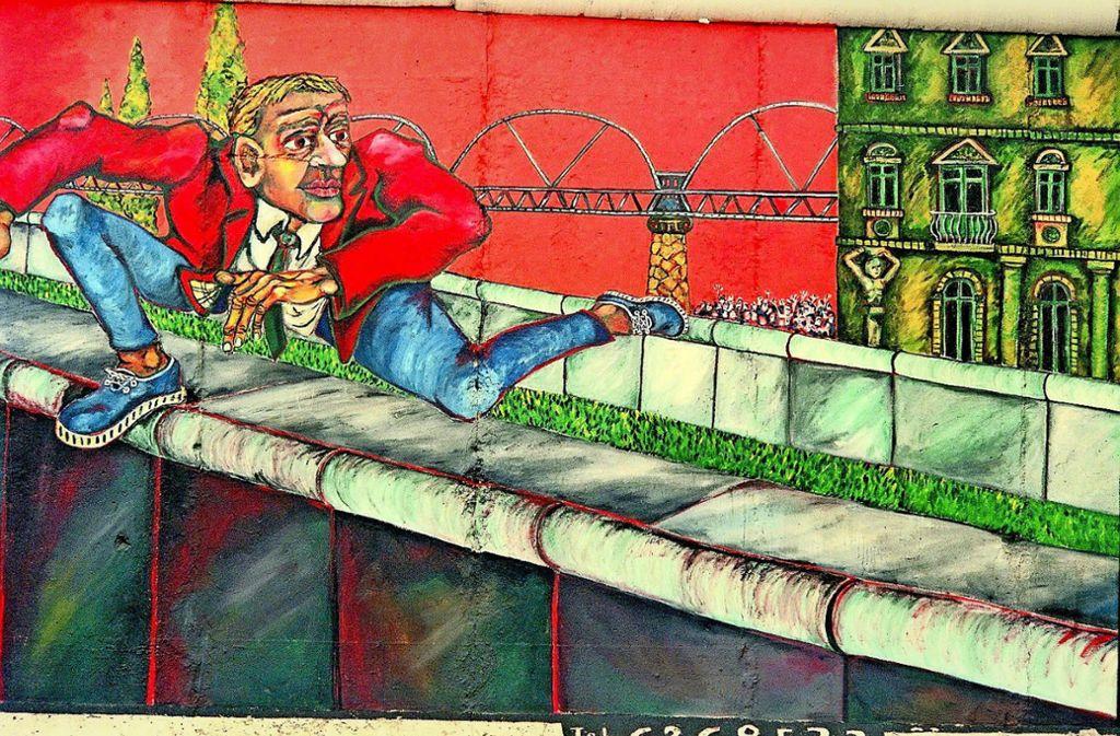 """Der plakative """"Mauerspringer"""" stammt von dem französischen Künstler Gabriel Heimler, der vor dem Mauerfall in der DDR lebte. Der Waiblinger Fotograf Jo Hinko hat ihn verewigt. Foto: Jo Hinko"""