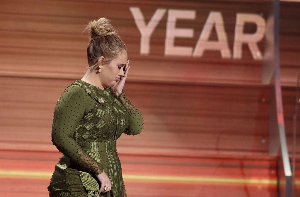 Adele muss ihre Tournee abbrechen und ist am Boden zerstört. Foto: Invision/AP