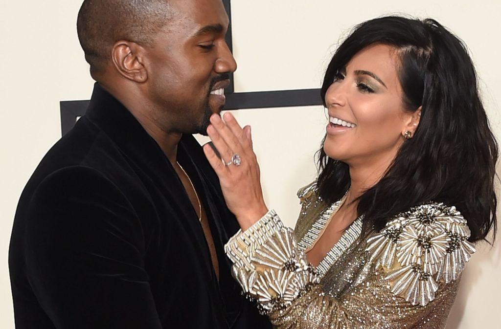 Rapper Kanye West und seine Frau, Reality-TV-Star Kim Kardashian West, sollen Uganda besuchen. Foto: Invision