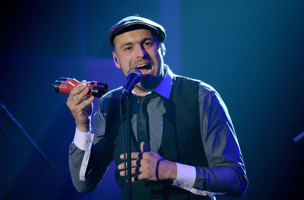 Als Popstar ist die Mütze zu seinem Markenzeichen geworden. Foto: dpa