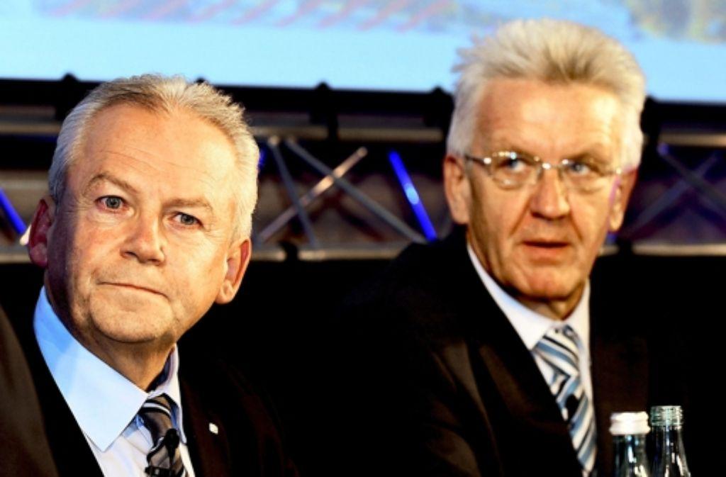Bahnchef Grube (l.) und Ministerpräsident Kretschmann haben beim Bahngipfel über den Schienenausbau beraten. Foto: dpa