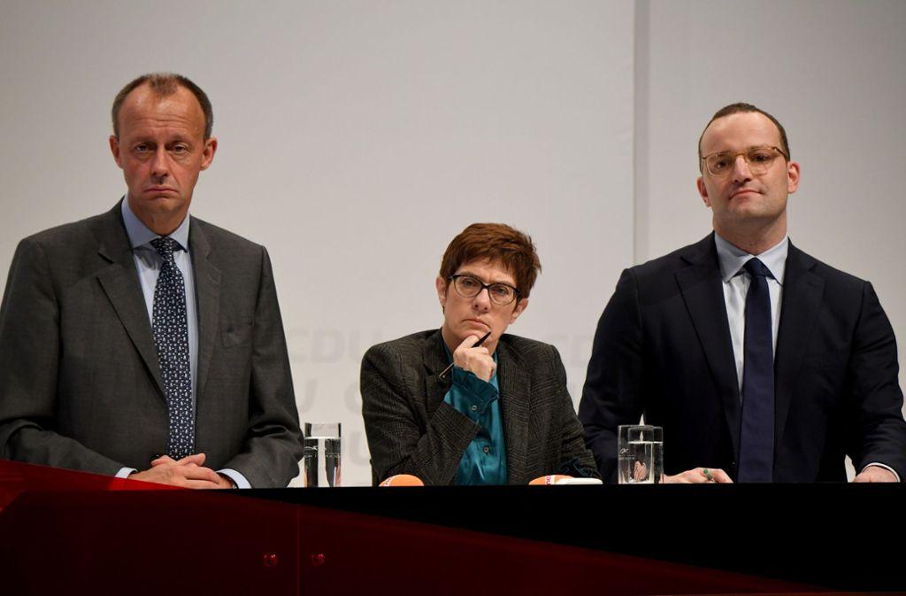 Friedrich Merz, Annegret Kramp-Karrenbauer und Jens Spahn (von links) bringen sich in Position. Foto: dpa