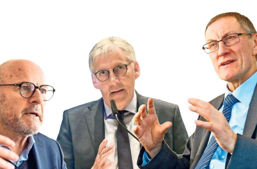 Verkehrsminister Winfried Hermann und die beiden Landräte Helmut Riegger und Roland Bernhard. Foto: dpa, factum/Archiv (2)
