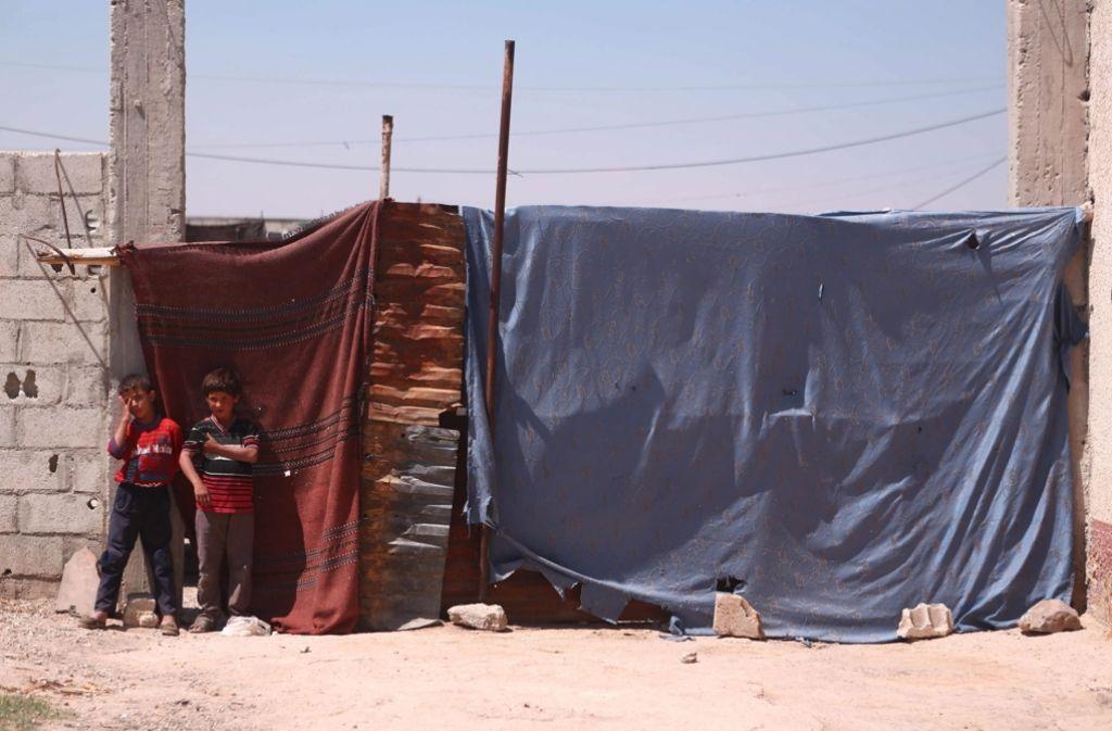 Kinder in einem Vorort von Damaskus. Foto: EPA