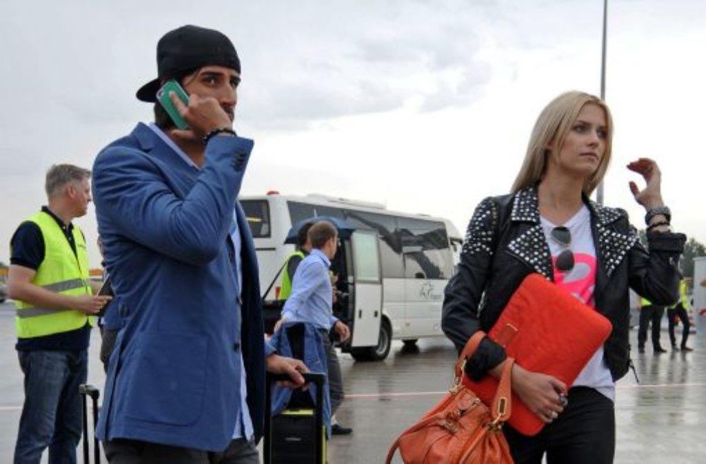 Lena Gercke mit ihrem Verlobten Sami Khedira. Foto: dapd