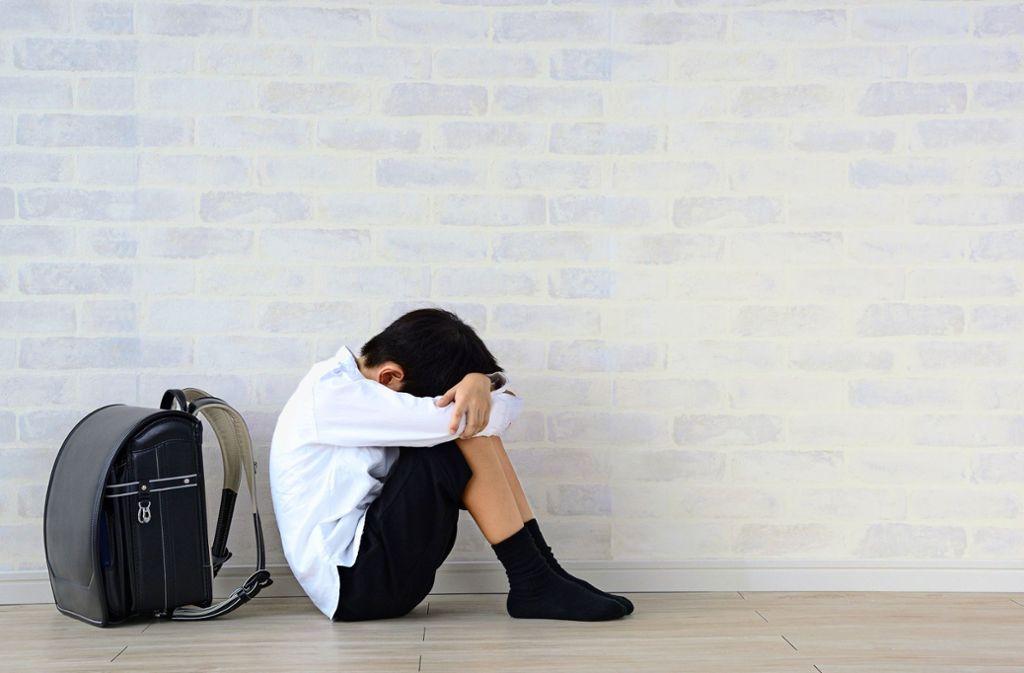 Mobbing ist in japanischen Schulen verbreitet (Symbolbild): Die Zahl bekannt gewordener Fälle ist zuletzt auf einen Rekordwert gestiegen. Foto: Adobe Stock/Takasu