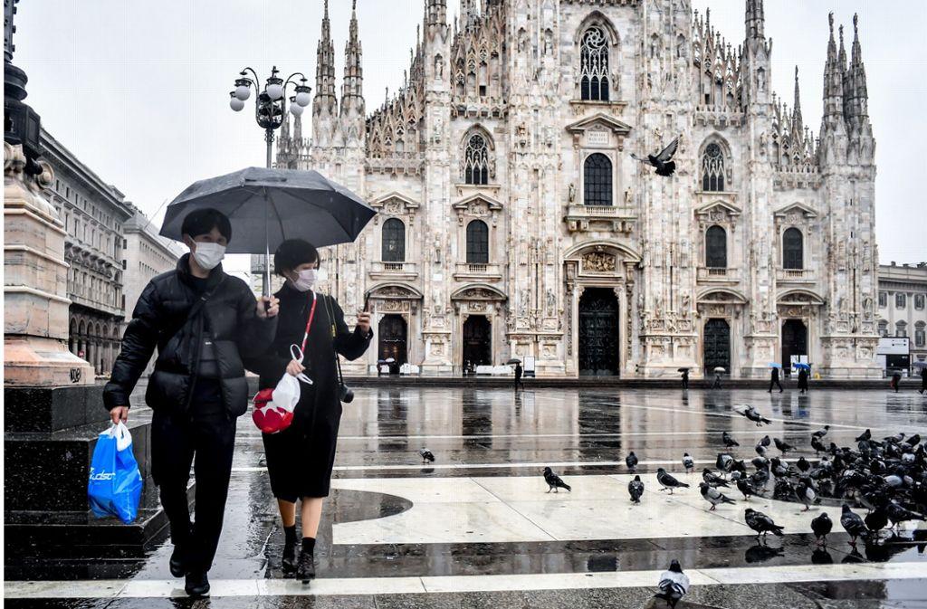 In Mailand sind vor allem Tauben auf der Suche nach Futter zu  beobachten. Foto: dpa/Claudio Furlan