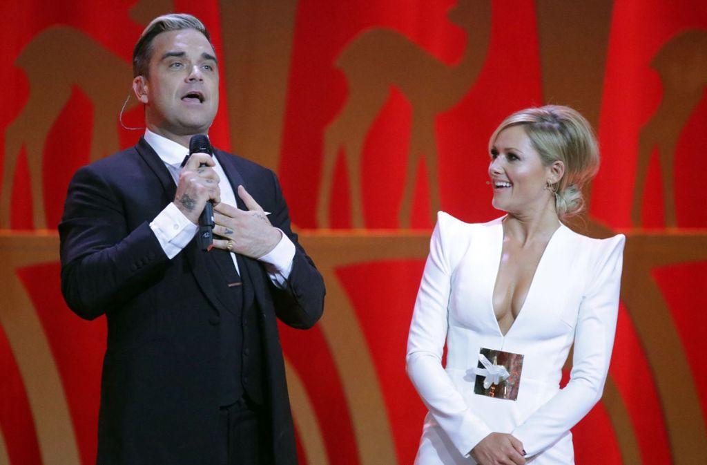 Robbie Williams und Helene Fischer nehmen ein Duett auf. Foto: dpa/Michael Kappeler