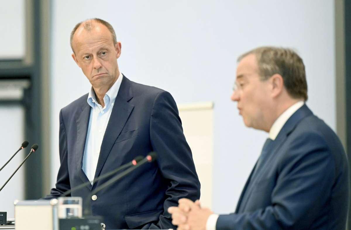 Armin Laschet (rechts) und Friedrich Merz in Stuttgart Foto: dpa/Bernd Weißbrod