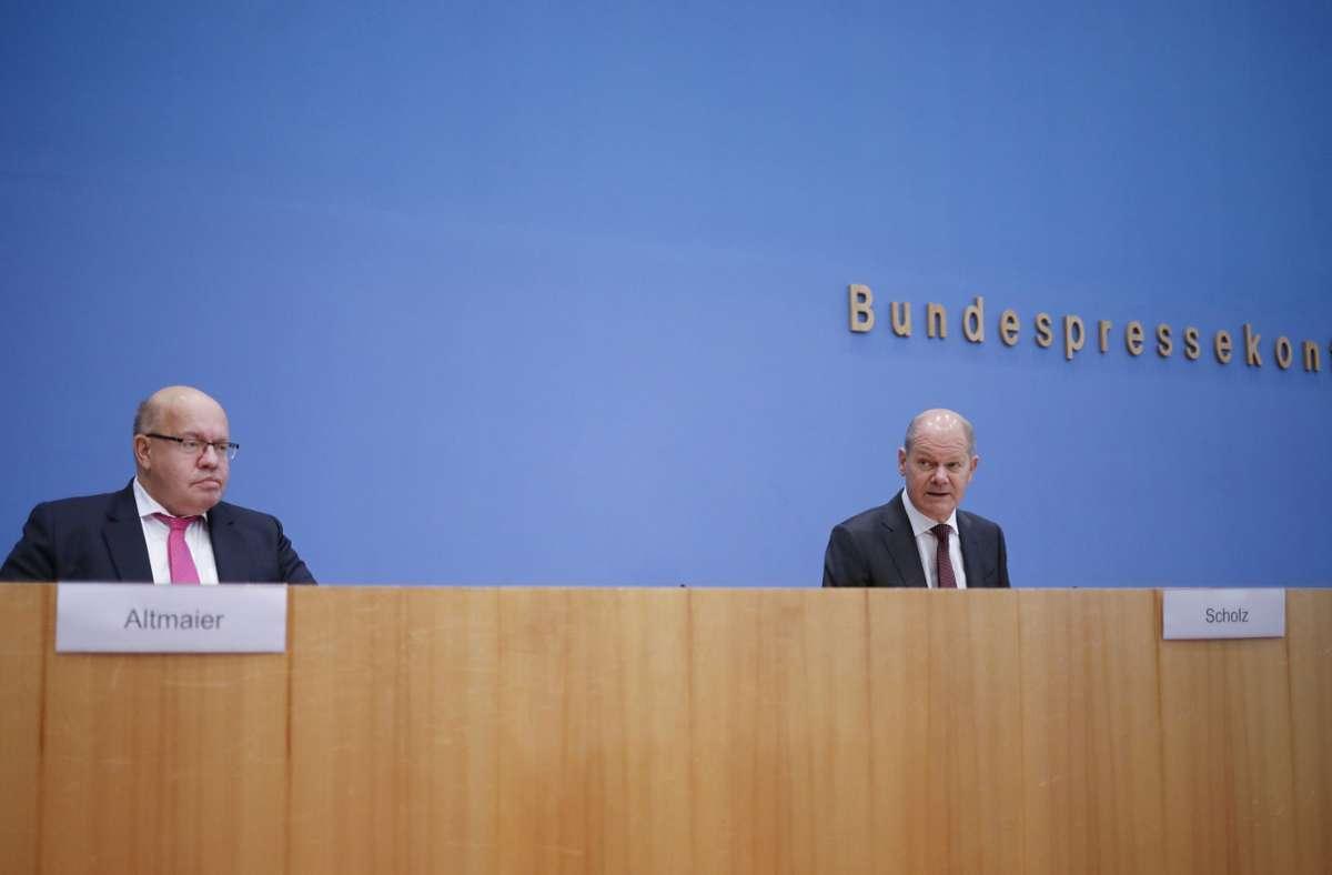 Peter Altmaier und Olaf Scholz bei der Pressekonferenz zu den neuen Corona-Hilfen. Foto: dpa/Markus Schreiber
