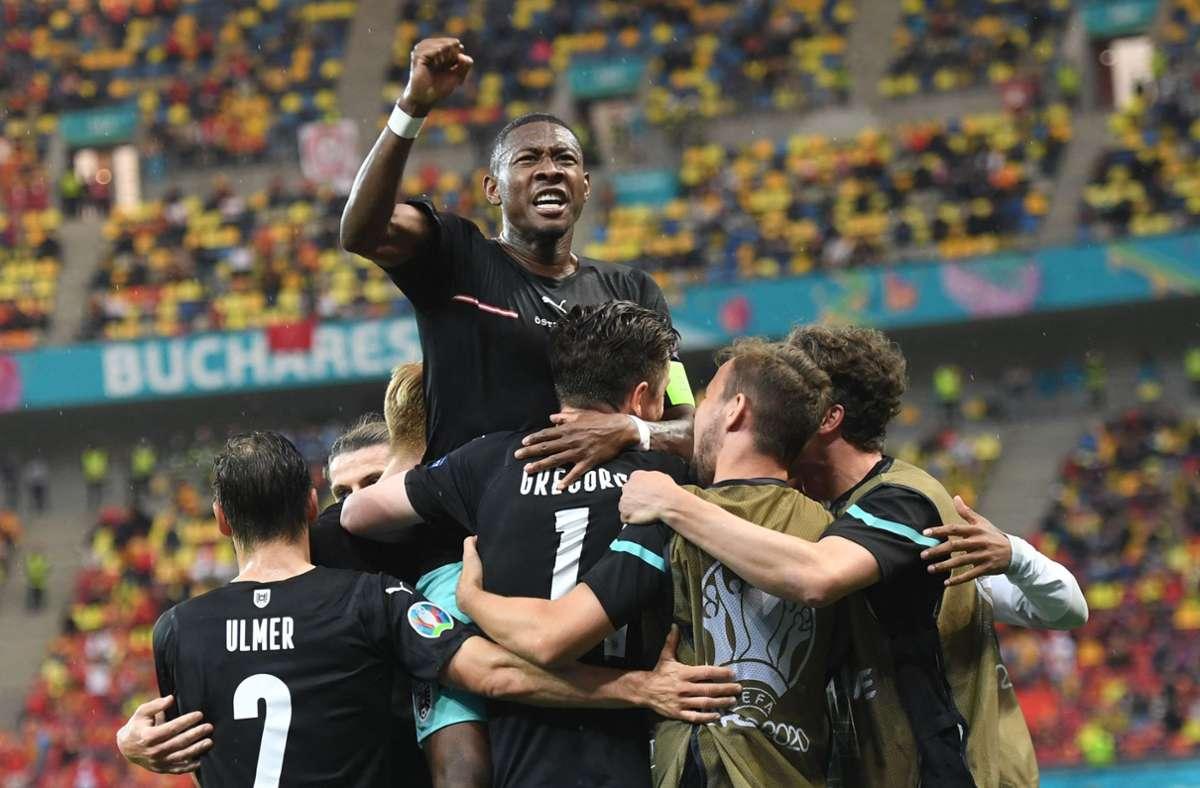 Österreich jubelt über den ersten Sieg bei einer EM. Foto: AFP/DANIEL MIHAILESCU