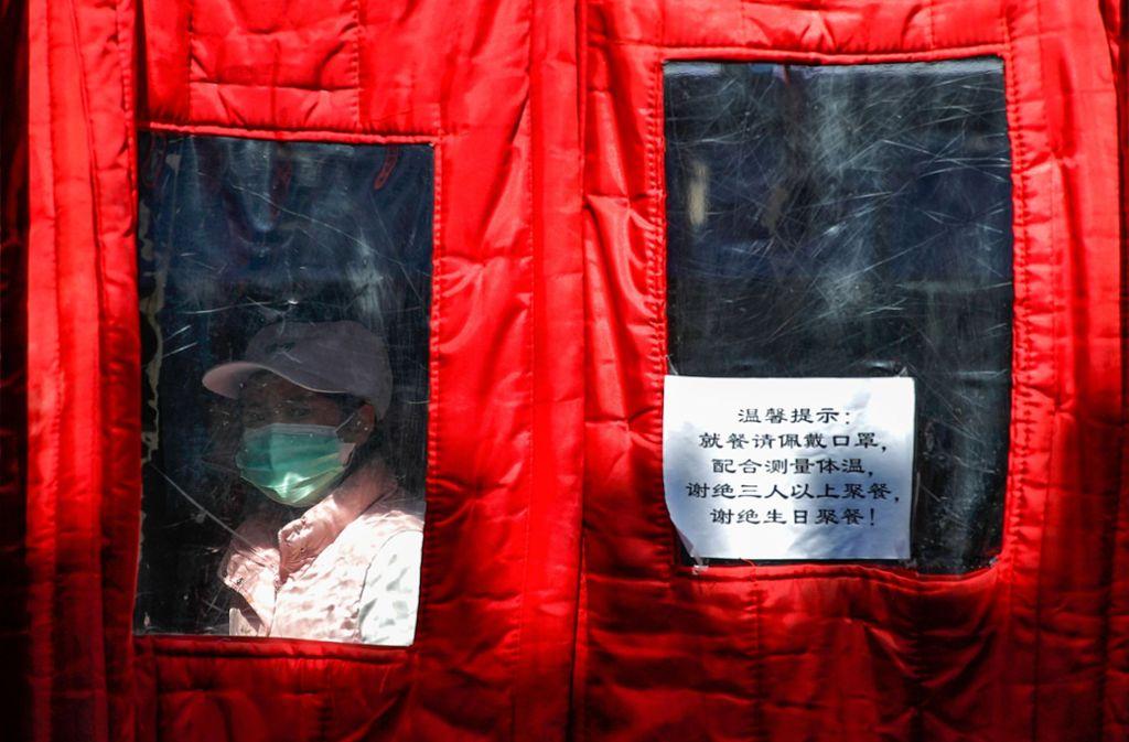 In China nahm die Zahl der Infektionen und Todesfälle durch das Coronavirus erneut zu. Foto: dpa/Andy Wong