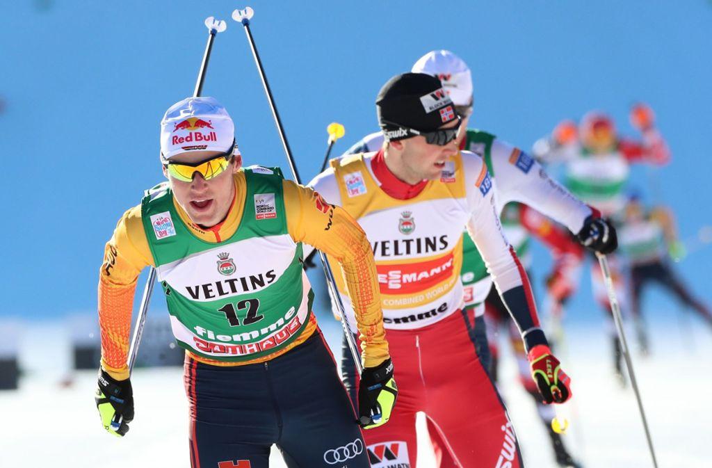 Vinzenz Geiger (li.) hat in dieser Saison gut lachen – und auch schon den Topmann aus Norwegen geschlagen. Foto: dpa/Espa Photo Agency