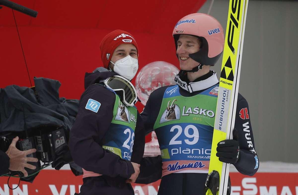Karl Geiger (re.) und Teamkollege Markus Eisenbichler. Foto: dpa