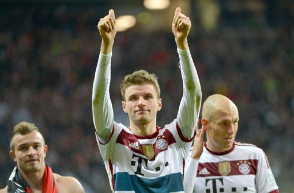 Die Freude wird jetzt nicht bis Weihnachten anhalten. Bayern Münchens Angreifer Thomas Müller nach seinem Dreierpack beim 4:0 in Frankfurt. Foto: dpa