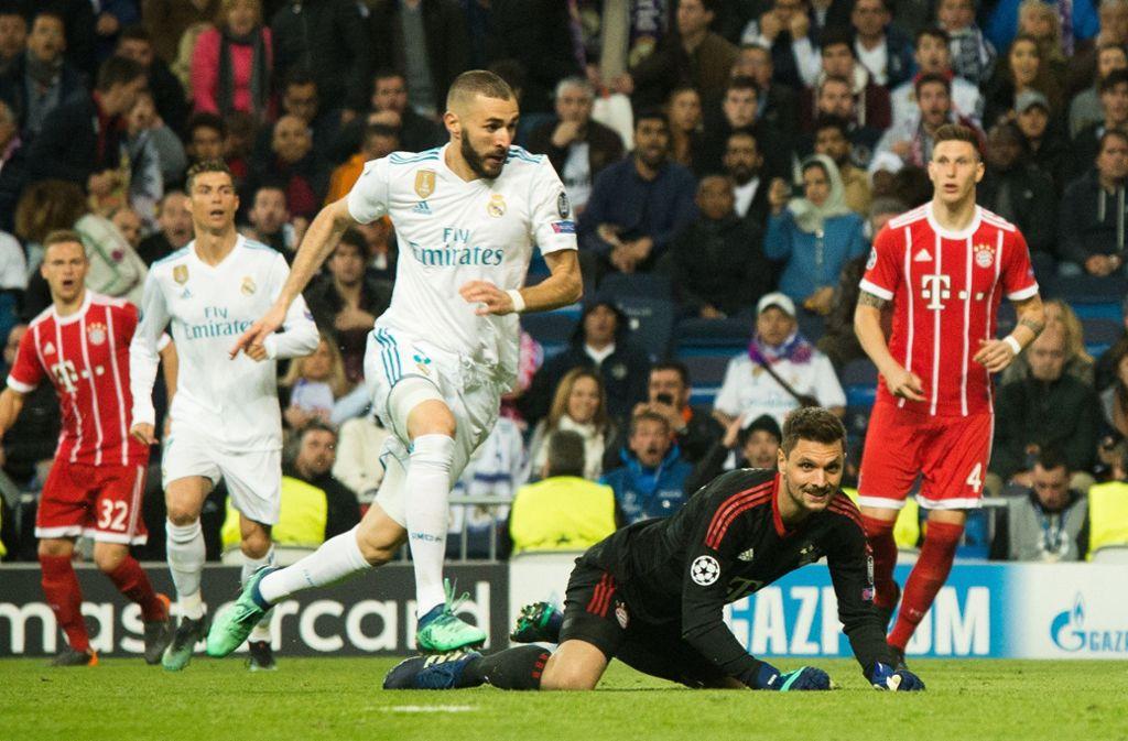 Am Boden: Sven Ulreich patzt, Karim Benzema ist der Nutznießer. Foto: dpa