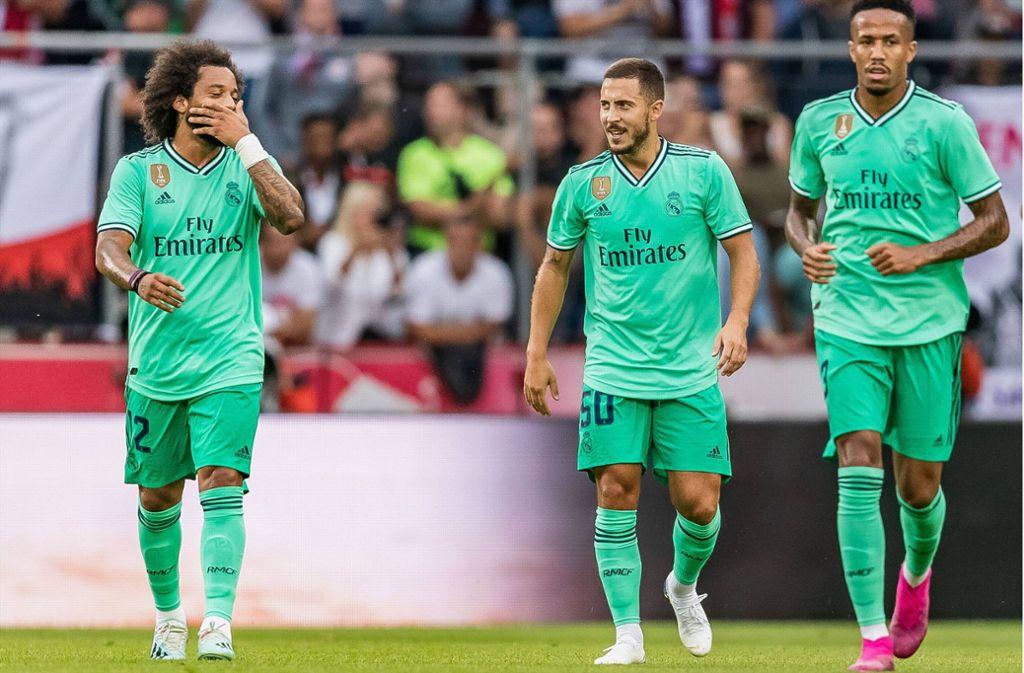 Grüne Männchen: Die Real-Profis Marcelo,  Eden Hazard und Eder Militao in ungewohnter Farbe Foto: imago//Jürgen Feichter