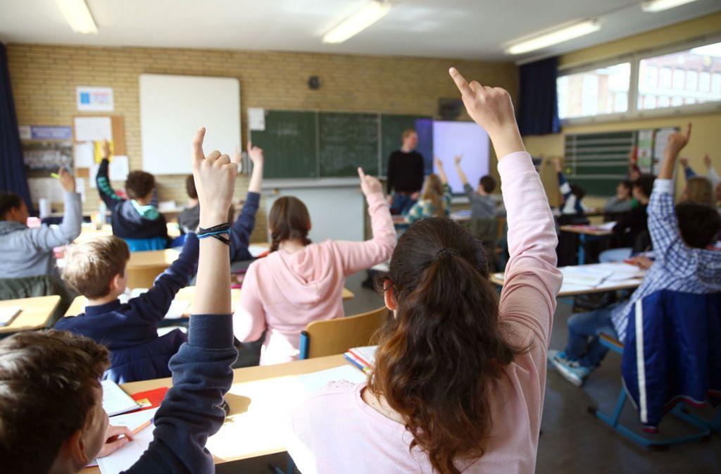 So gesittet wie in dieser Klasse geht es nicht überall zu. Foto: dpa