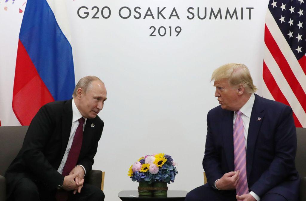 Russlands Staatschef Wladimir Putin (links) mit dem US-Präsidenten Donald Trump. Foto: AFP