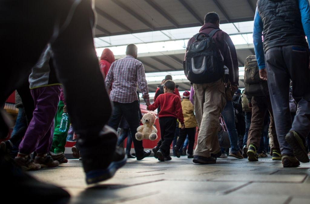 Flüchtlinge kommen am Bahnhof in München an (Symbolbild). Foto: dpa