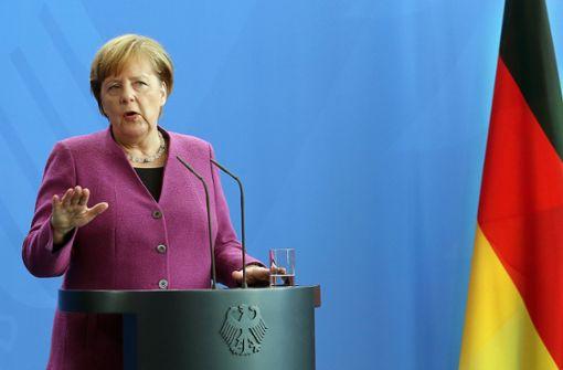 Merkel hält den Schulterschluss mit Trump und Macron
