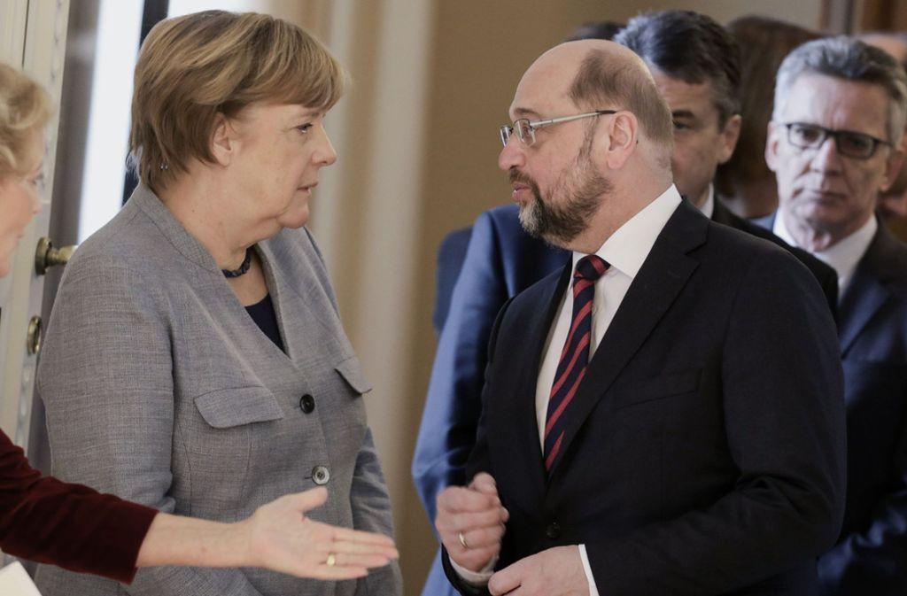 Kanzlerin Angela Merkel und  SPD-Chef Martin Schulz müssen noch viele inhaltliche Hürden überwinden. Foto: dpa