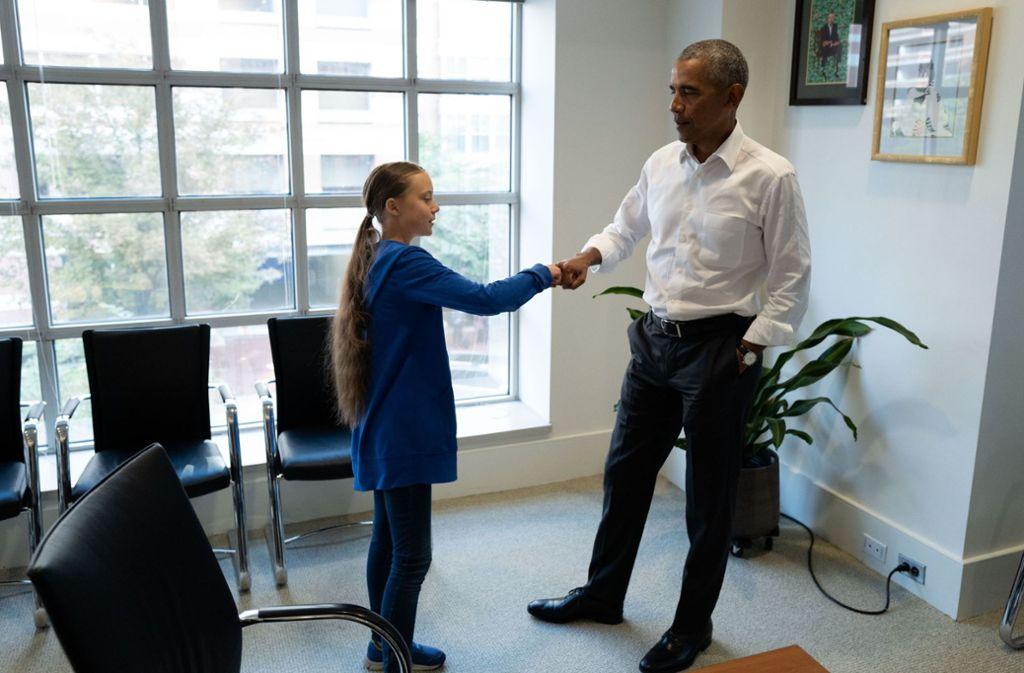 Der frühere US-Präsident Barack Obama trifft die Klima-Aktivistin Greta Thunberg. Foto: AFP