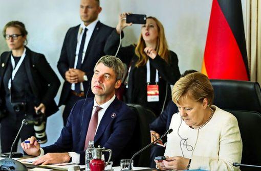 Merkels Mann für eine Welt in Aufruhr