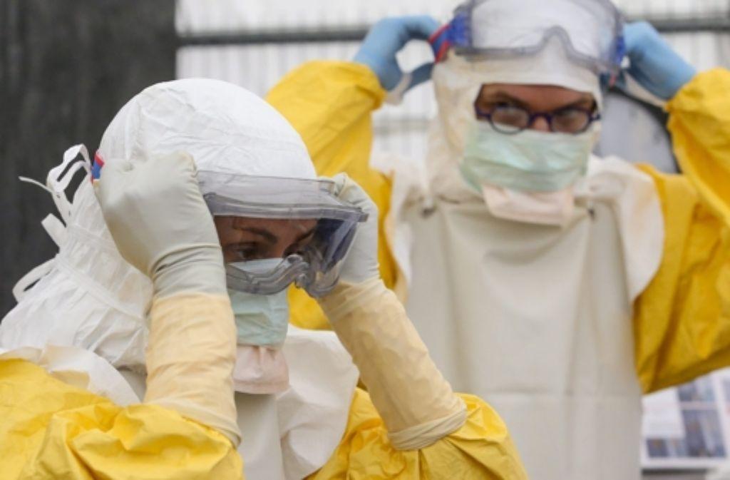 Nur mit strengen Hygieneregeln kann man sich vor Ebola schützen. Foto: EPA