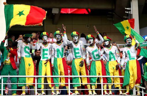 Fans von Senegal und Japan zeigen schwäbische Tugenden