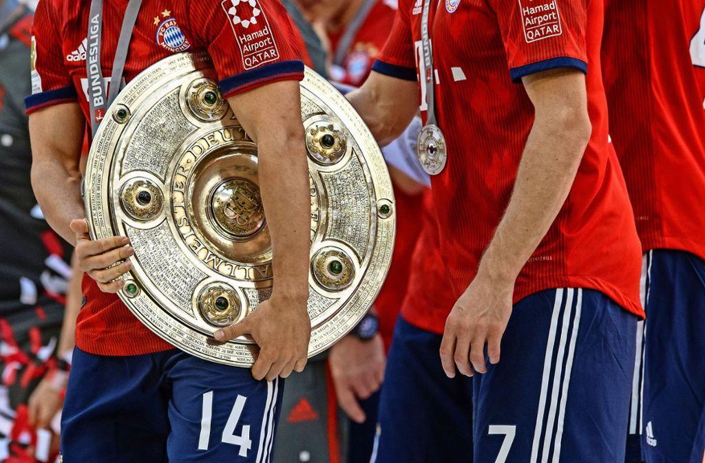 Und ewig jubeln die Bayern. Geht es nach Ralf Rangnick, könnte ein Ende von 50+1 die Münchner Vormachtstellung ins Wanken bringen. Foto: dpa