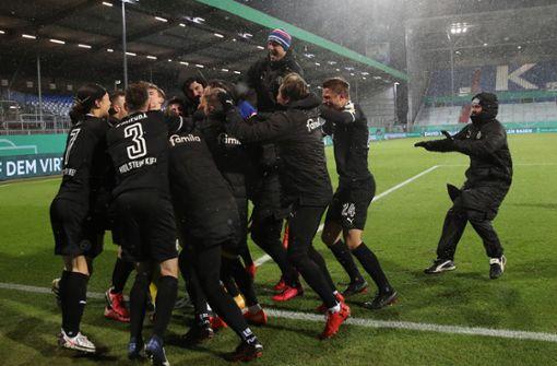 Zweitligist Holstein Kiel schießt Rekordmeister aus dem DFB-Pokal