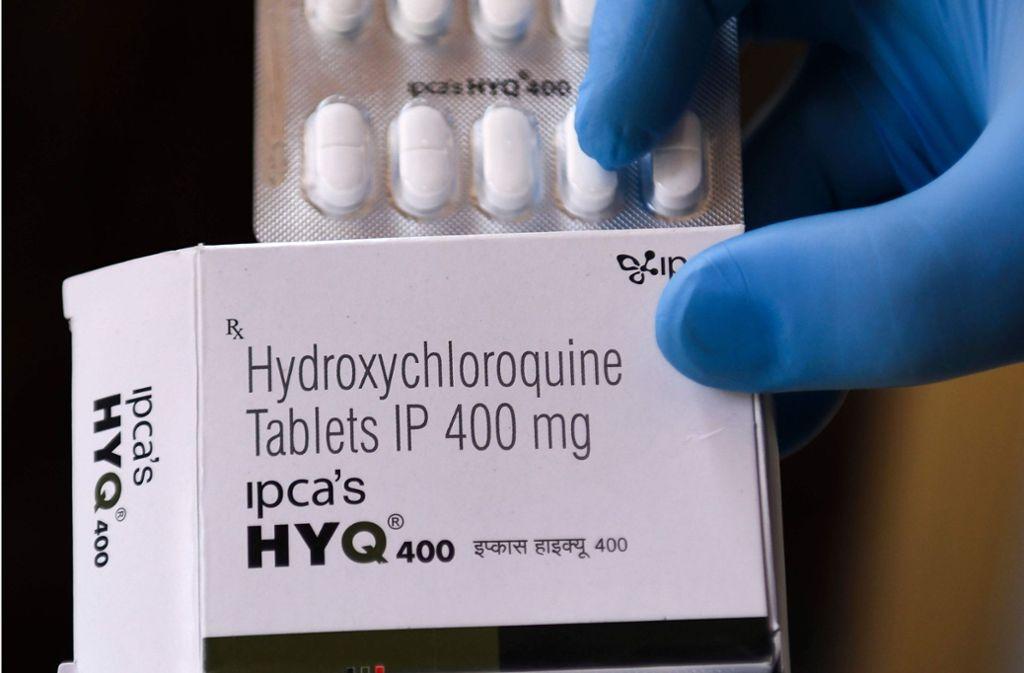 Bis zu zwei Wochen liegt die Studie der Tübinger Mediziner zu Chloroquin erst einmal auf Eis. Foto: AFP/NARINDER NANU