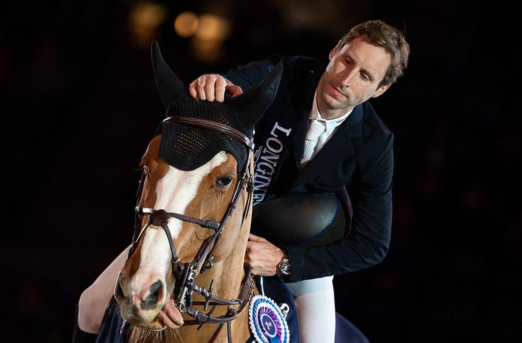 Pieter Devos und sein Wallach Apart gewinnen den Großen Preis von Stuttgart. Foto: dpa
