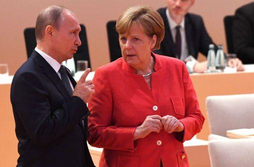 Merkel und Putin wollen am Iran-Abkommen festhalten