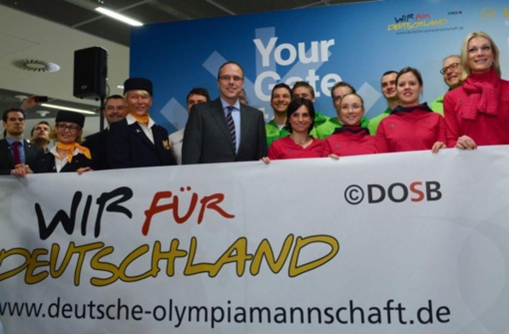 Wir für Deutschland - die deutschen Athleten sind nun von Frankfurt aus nach Sotschi geflogen. Foto: dpa