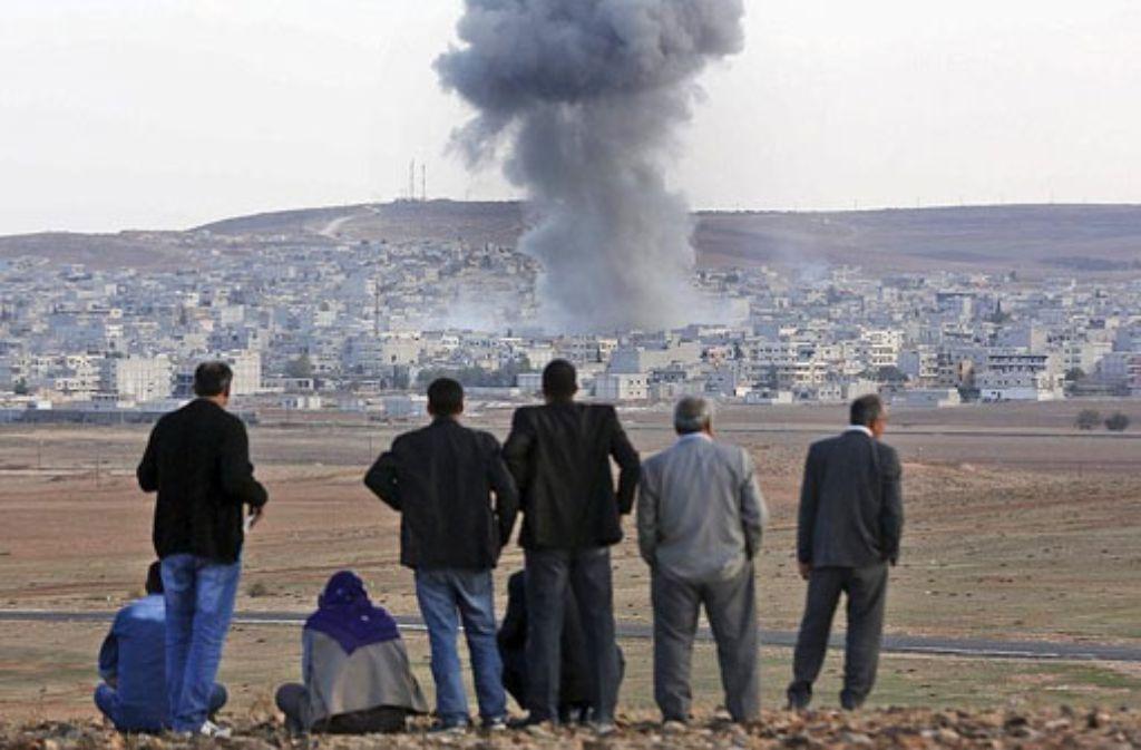 Die Grenzstadt Kobane wird seit Wochen hart umkämpft. (Archivfoto) Foto: dpa