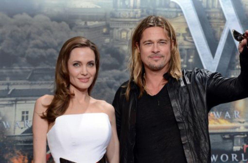 Jolies 38. Geburtstag und die Deutschlandpremiere von Pitts neuem Film - in Berlin gab es für das Promi-Paar gleich doppelten Grund zu feiern.  Foto: dpa