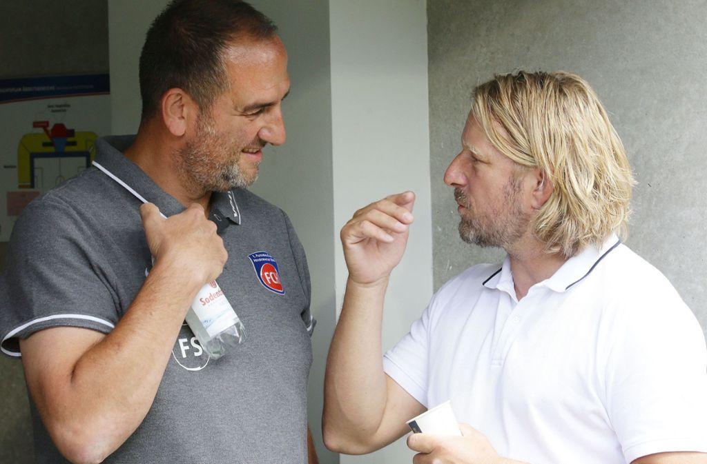 Starke Persönlichkeiten unter sich: FCH-Trainer Frank Schmidt (li.), VfB-Sportvorstand Sven Mislintat Foto: Baumann