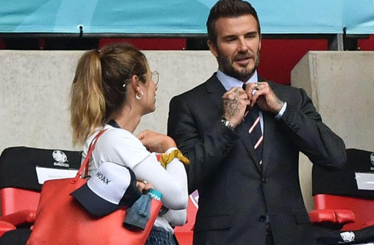 David Beckham im Gespräch mit einem Fan. Foto: AFP/JUSTIN TALLIS