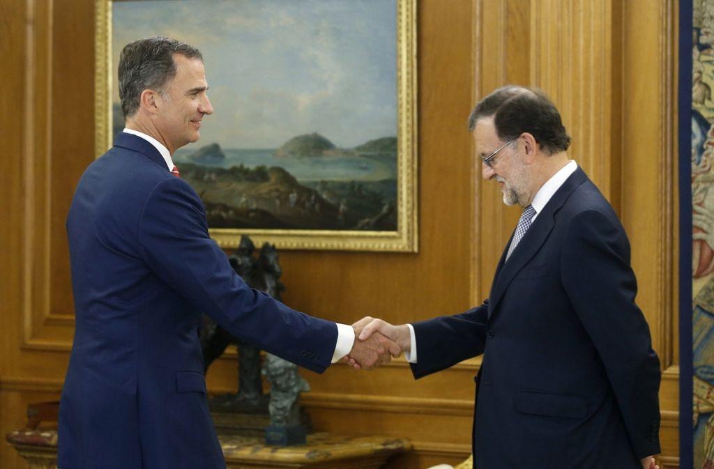 Spanien König Felipe VI. beauftragt Ministerpräsident Rajoy, eine Regierung zu bilden. Foto: dpa